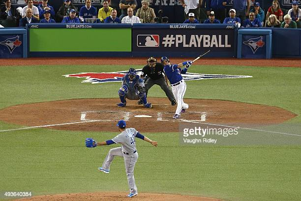 Troy Tulowitzki of the Toronto Blue Jays hits a three-run RBI double in the sixth inning against the Kansas City Royals during game five of the...