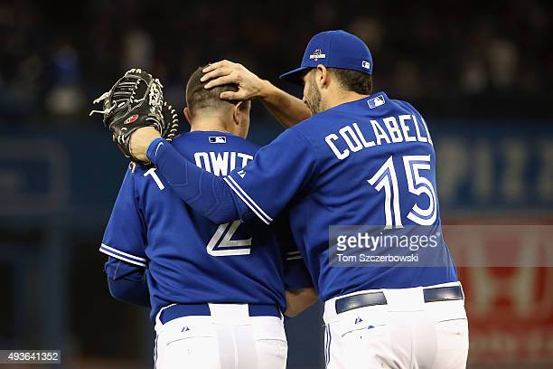 Troy Tulowitzki of the Toronto Blue Jays is congratulated by Chris Colabello of the Toronto Blue Jays after the end of the sixth inning during game...