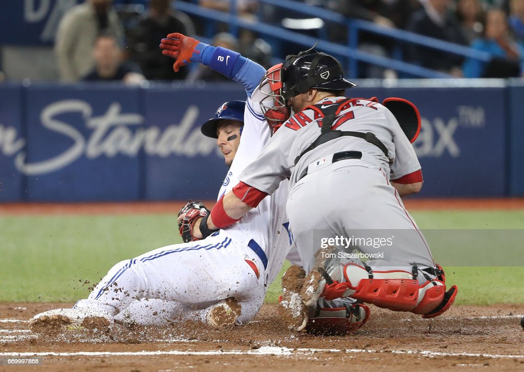 Troy Tulowitzki #2 of the Toronto Blue Jays is thrown out at home plate in the first inning during MLB game action as Christian Vazquez #7 of the Boston Red Sox tags him out at Rogers Centre on April 18, 2017 in Toronto, Canada.