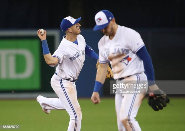 Troy Tulowitzki of the Toronto Blue Jays makes the play and throws out the baserunner as Josh Donaldson turns away in the ninth inning during MLB...