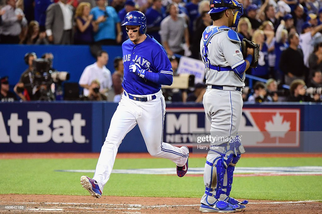 Troy Tulowitzki #2 of the Toronto Blue Jays scores a run in front of Salvador Perez #13 of the Kansas City Royals to take a 7-1 lead in the eighth inning during game five of the American League Championship Series at Rogers Centre on October 21, 2015 in Toronto, Canada.