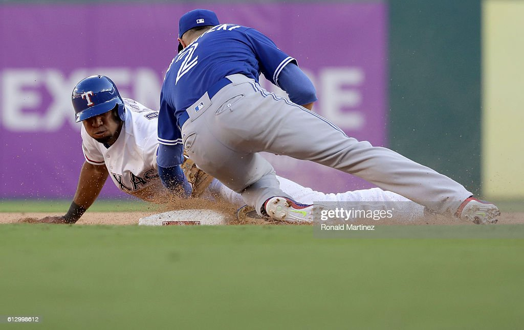 Troy Tulowitzki #2 of the Toronto Blue Jays tags out Elvis Andrus #1 of the Texas Rangers at second base during the sixth inning in game one of the American League Divison Series at Globe Life Park in Arlington on October 6, 2016 in Arlington, Texas.