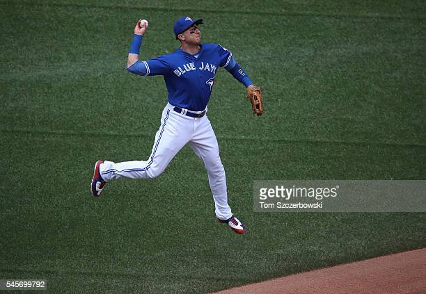 Troy Tulowitzki of the Toronto Blue Jays throws out the baserunner in the fifth inning during MLB game action against the Detroit Tigers on July 9...