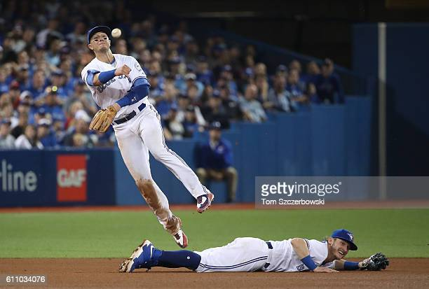 Troy Tulowitzki of the Toronto Blue Jays throws out the baserunner to end the seventh inning as Josh Donaldson gets out of the way during MLB game...