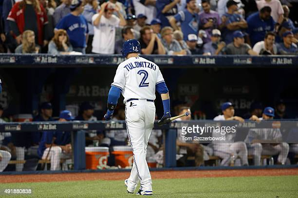Troy Tulowitzki of the Toronto Blue Jays walks back to the dugout after being struck by Sam Dyson of the Texas Rangers in the ninth inning during...