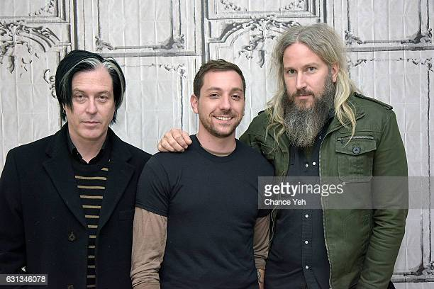 Troy van Leeuwen Mike Zarin and Troy Sanders of the Band Gone is Gone attend the Build Series to discuss Echolocation at AOL HQ on January 9 2017 in...