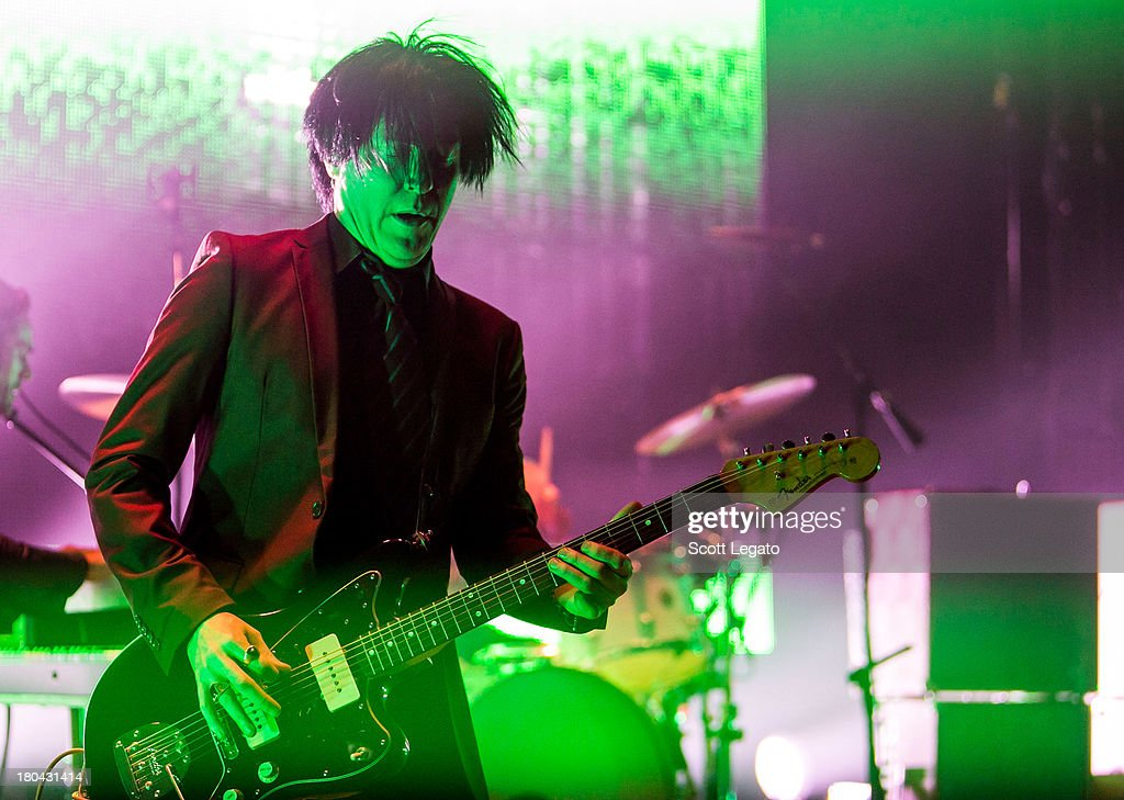 Troy Van Leeuwen of Queens of the Stone Age performs in concert at The Fillmore on September 12, 2013 in Detroit, Michigan.