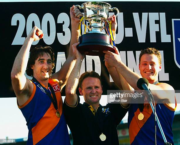 Troy West coach Brad Gotch and Brad Lloyd for Williamstown with the trophy after the VFL Grand Final between Williamstown and Box Hill played at...