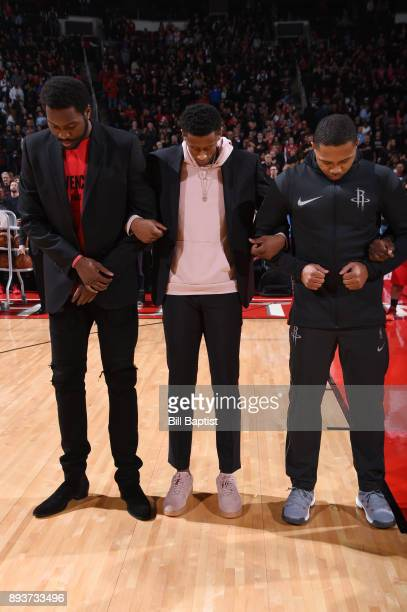 Troy Williams and Eric Gordon of the Houston Rockets stand for the National Anthem before the game against the San Antonio Spurs on December 15 2017...