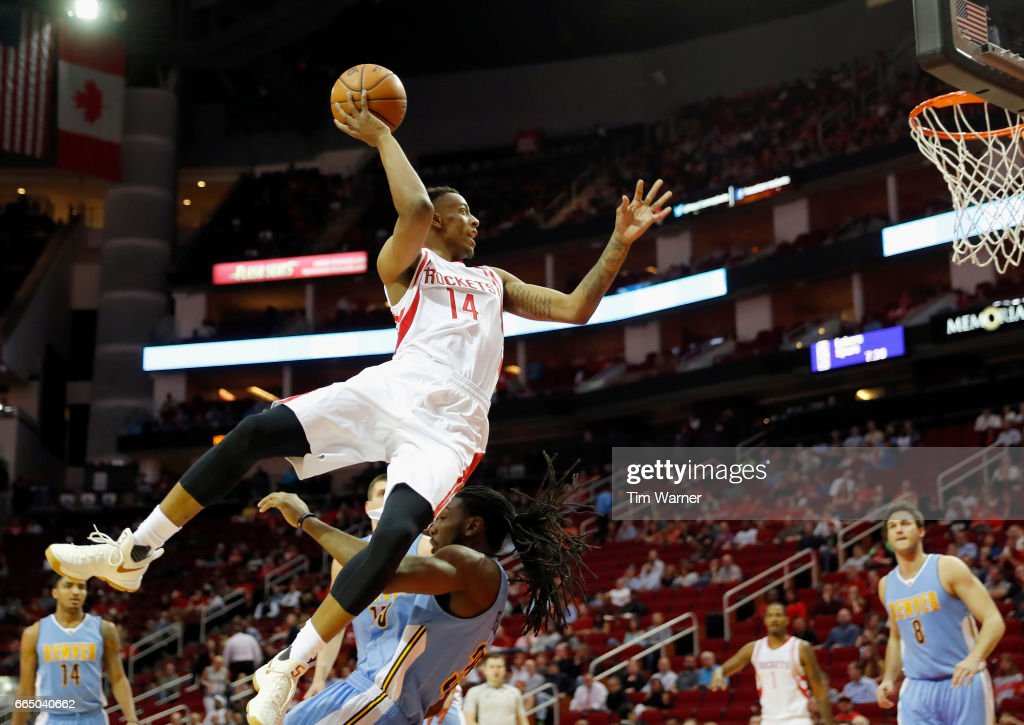 Troy Williams #14 of the Houston Rockets drives to the basket and is fouled by Kenneth Faried #35 of the Denver Nuggets in the first half at Toyota Center on April 5, 2017 in Houston, Texas.