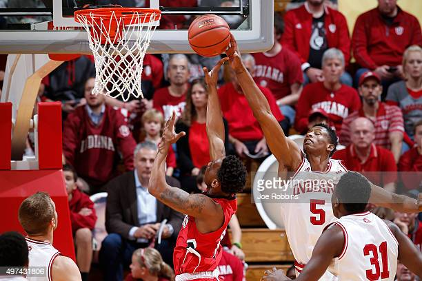 Troy Williams of the Indiana Hoosiers blocks a shot by Terrell Thompson of the Austin Peay Governors in the first half of a game at Assembly Hall on...