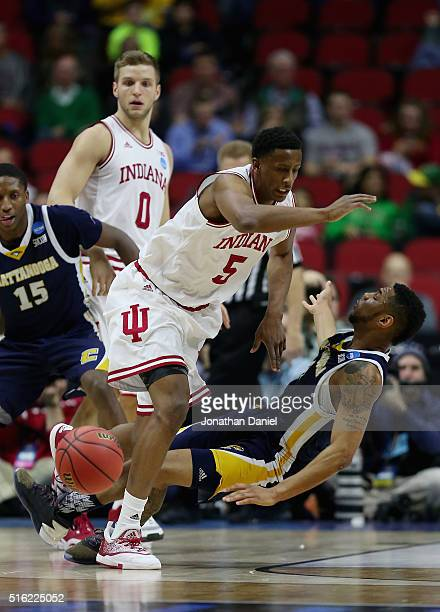 Troy Williams of the Indiana Hoosiers collides with Johnathan Burroughs-Cook of the Chattanooga Mocs in the first half during the first round of the...