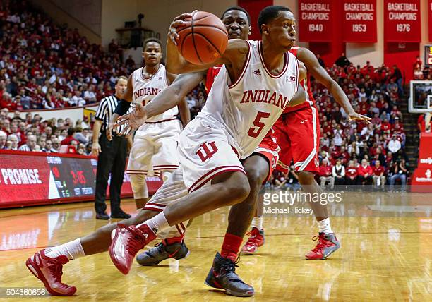 Troy Williams of the Indiana Hoosiers makes a move to the basket against Jae'Sean Tate of the Ohio State Buckeyes at Assembly Hall on January 10 2016...