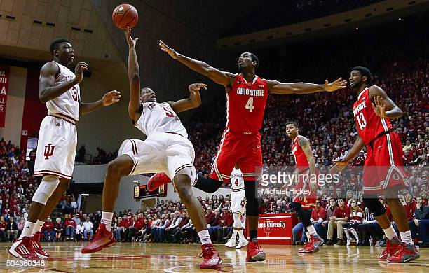 Troy Williams of the Indiana Hoosiers shoots an offbalance shot as Daniel Giddens of the Ohio State Buckeyes defends at Assembly Hall on January 10...