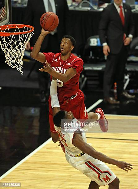Troy Williams of the Indiana Hoosiers shoots over Jonathan Graham of the Maryland Terrapins during the quarterfinal round of the 2015 Big Ten Men's...