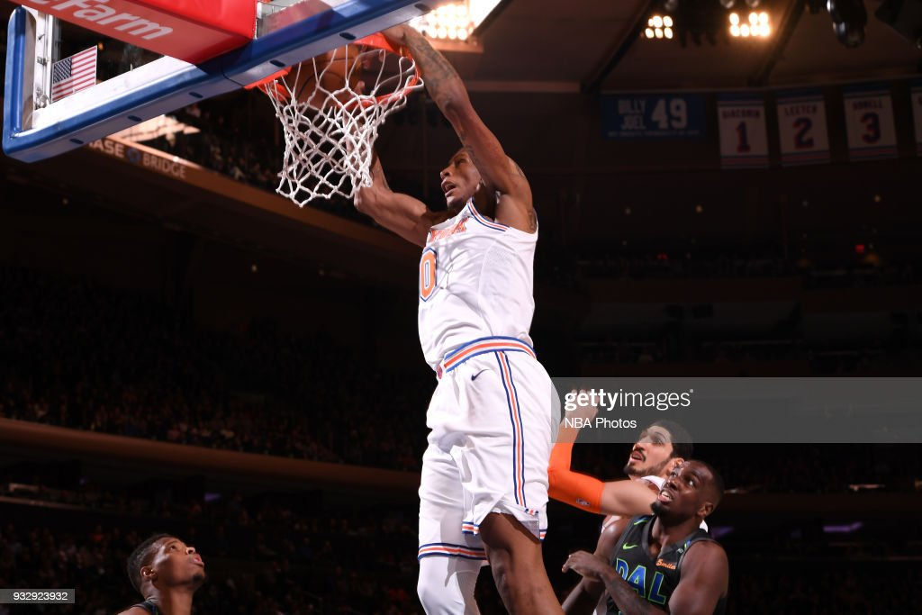 Troy Williams #0 of the New York Knicks dunks the ball during the game Dallas Mavericks on March 13, 2018 at Madison Square Garden in New York City, New York.