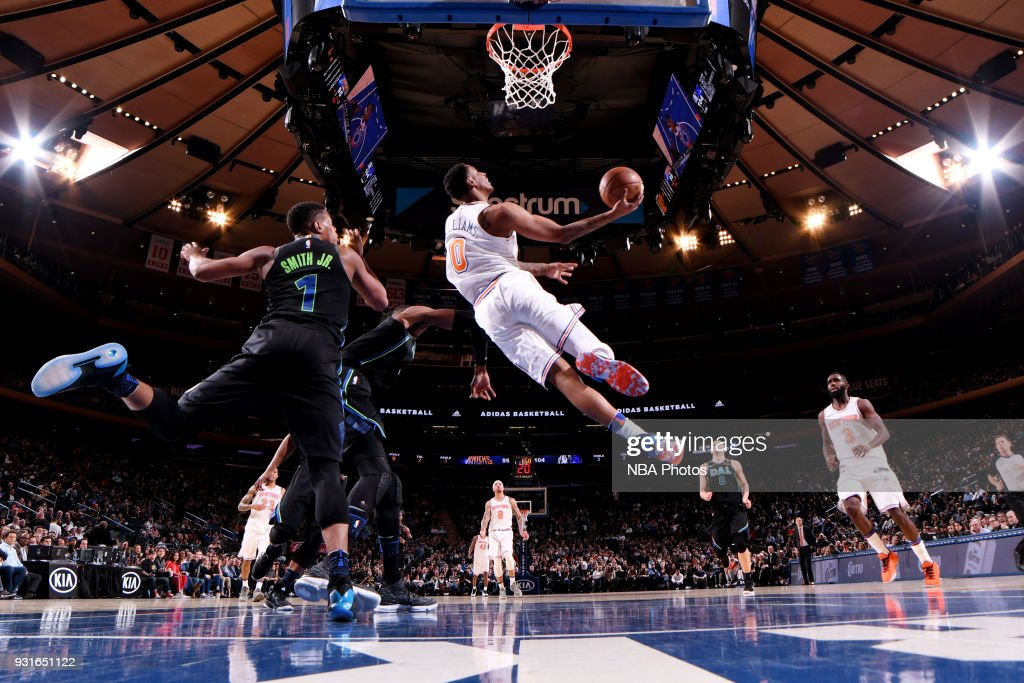 Troy Williams #0 of the New York Knicks shoots the ball during the game against the Dallas Mavericks on March 13, 2018 at Madison Square Garden in New York City, New York.