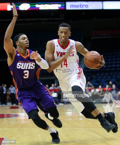 Troy Williams of the Rio Grande Valley Vipers drives the ball to the net on Shaquille Harrison of the Northern Arizona Suns at the State Farm Arena...