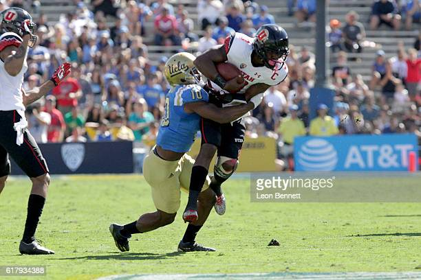 Troy Williams of the Utah Utes gets tackled by Fabian Moreau of the UCLA Bruins during PAC12 college football game at Rose Bowl on October 22 2016 in...
