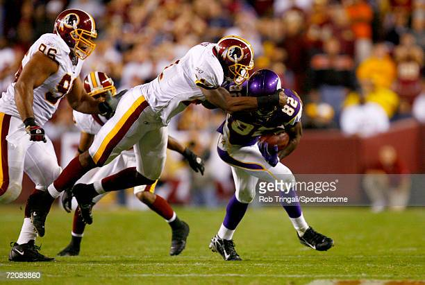 Troy Williamson of the Minnesota Vikings runs with the ball and gets facemasked by Sean Taylor of the Washington Redskins on September 11 2006 at...