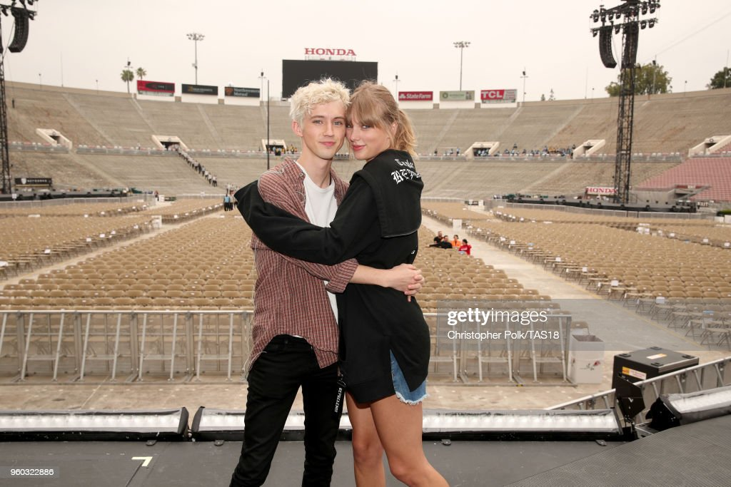 Troye Sivan and Taylor Swift pose onstage during the Taylor Swift reputation Stadium Tour at the Rose Bowl on May 19, 2018 in Pasadena, California