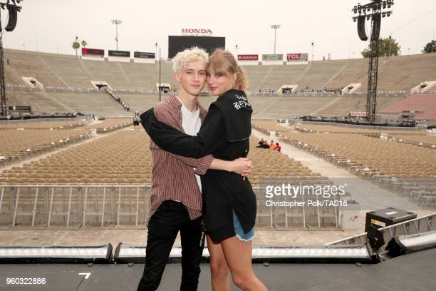 Troye Sivan and Taylor Swift pose onstage during the Taylor Swift reputation Stadium Tour at the Rose Bowl on May 19 2018 in Pasadena California