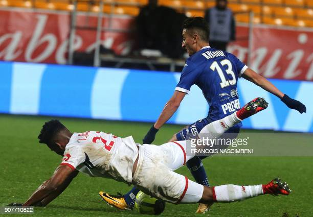 Troyes' Algerian midfielder SaîfEddine Khaoui vies with Lille's Brazilian midfielder Thiago Mendes during the French L1 football match between Troyes...