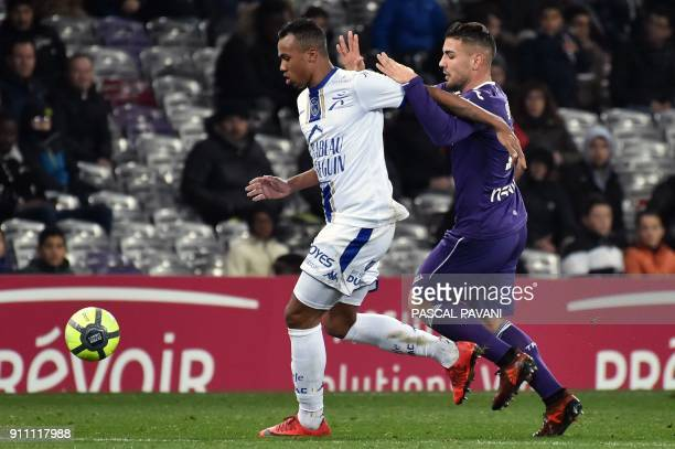 Troyes' Brazilian defender Gabriel Magalhaes outruns Toulouse's French forward Andy Delort during the French L1 football match Toulouse vs Troyes on...