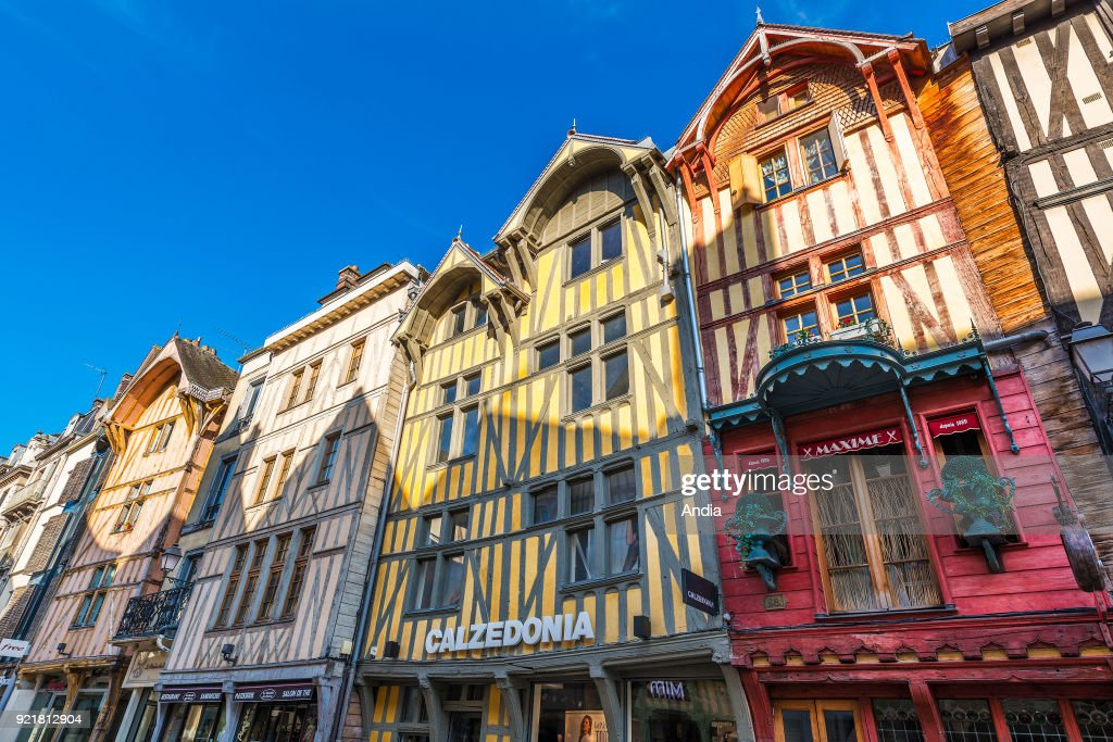 facades of traditional timber frame houses, typical from the Champagne area, in the street 'rue Emile Zola', in the city centre. Calzedonia shop sign.