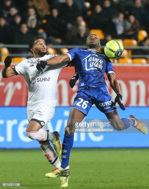 Troyes' forward Adama Niane vies with Dijon's French defender Valentin Rosier during the French L1 football match between Troyes and Dijon on...