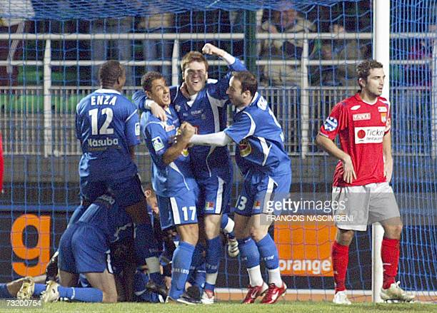 Troyes players jubilate after scoring a goal during the prolongations during their French L1 football match TroyesLyon 04 February 2007 at the Aube...