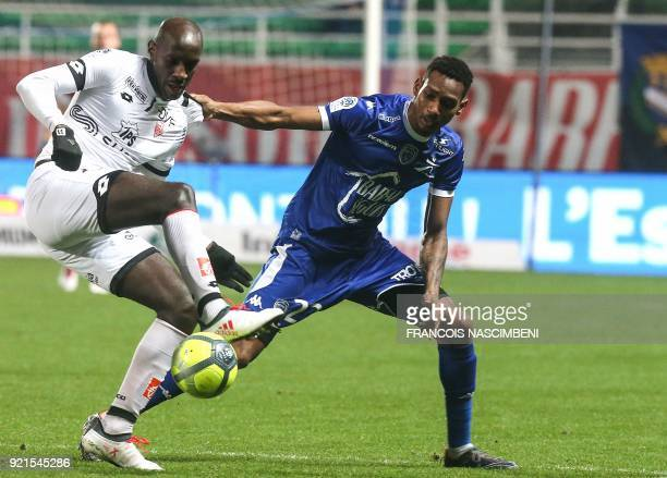 Troyes' French defender Christophe Herelle vies with Dijon's Cap Verde forward Julio Tavares during the French L1 football match between Troyes and...