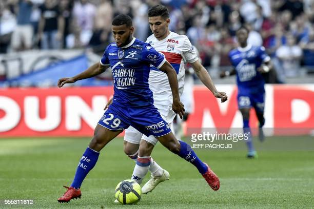 Troyes' French forward Samuel Grandsir vies with Lyon's forward Houssem Aouar during the French L1 football match Olympique Lyonnais vs ESTAC Troyes...