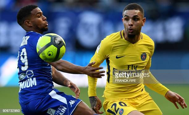 Troyes' French forward Samuel Grandsir vies with Paris SaintGermain's French defender Layvin Kurzawa during the French L1 football match between...