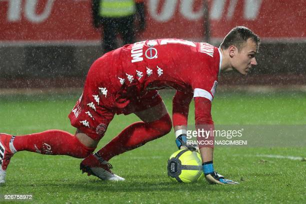 Troyes' French goalkeeper Erwin Zelazny stops the ball during the French L1 football match between Troyes and Paris SaintGermain at the Aube Stadium...