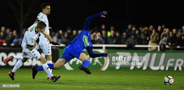 Troyes' French midfielder Alois Confais vies with Still's French forward JeanBaptiste Huck during the French Cup football match between Still and...