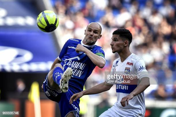 Troyes' French midfielder Benjamin Nivet vies with Lyon's forward Houssem Aouar during the French L1 football match Olympique Lyonnais vs ESTAC...