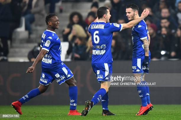 Troyes' French midfielder Bryan Pele is congratulated by teammates after he scored a goal during the French L1 football match between Marseille and...