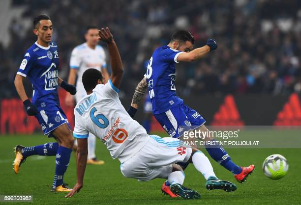Troyes' French midfielder Bryan Pele kicks to score a goal against Olympique de Marseille's Portuguese defender Rolando during the French L1 football...