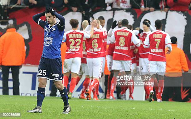 Troyes' French midfielder Jessy Pi reacts after his team conceded a goal during the French L1 football match between Reims and Troyes on December 5...