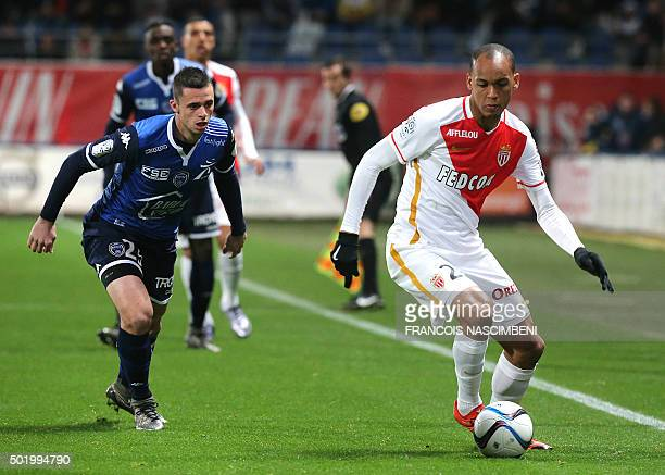 Troyes' French midfielder Jessy Pi vies for the ball with Monaco's Brazilian defender Fabinho during the French L1 football match between Troyes and...