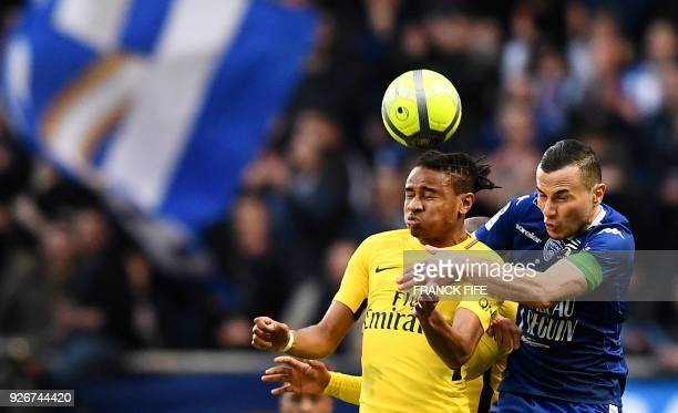 Troyes' French midfielder Karim Azamoum and Paris SaintGermain's French midfielder Christopher Nkunku head the ball during the French L1 football...