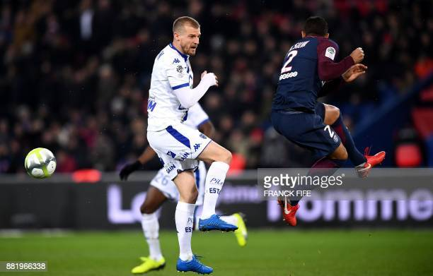 Troyes' French midfielder Stephane Darbion and Paris SaintGermain's Brazilian defender Thiago Silva head the ballduring the French L1 football match...