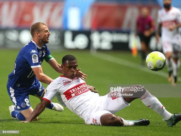 Troyes' French midfielder Stephane Darbion vies with Toulouse's French defender Issa Diop during the French L1 football match between Troyes and...