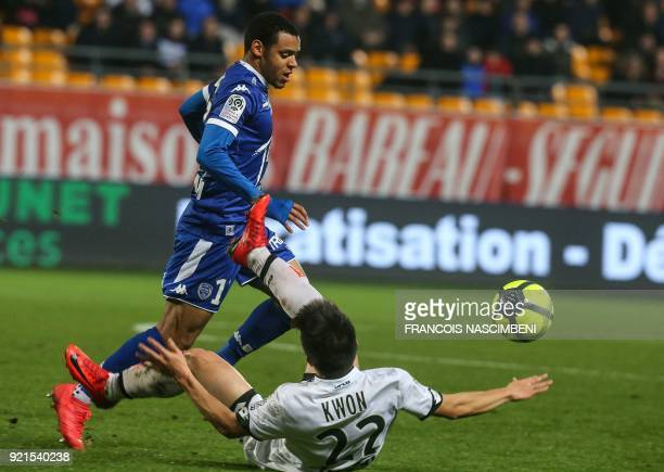 Troyes' Gabonese defender Johann Obiang vies with Dijon's SouthKorean midfielder Kwon Changhoon during the French L1 football match between Troyes...