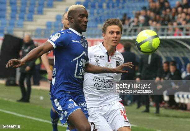 Troyes' Malian forward Adama Niane and Nice's French defender Arnaud Souquet go for the ball during the French L1 football match between Troyes and...