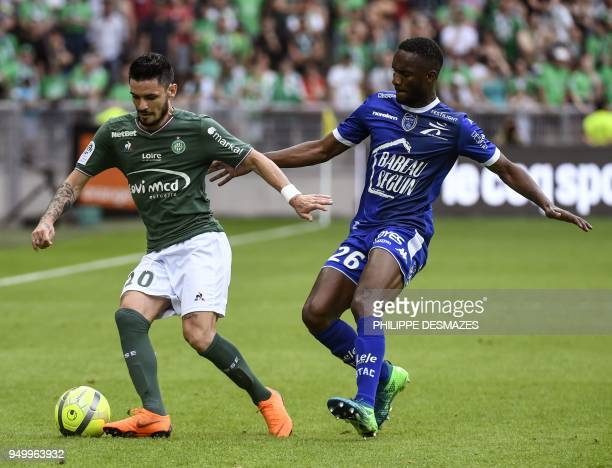 Troyes' Malian forward Adama Niane fights for the ball with SaintEtienne's French forward Remy Cabella during the French L1 football match between AS...