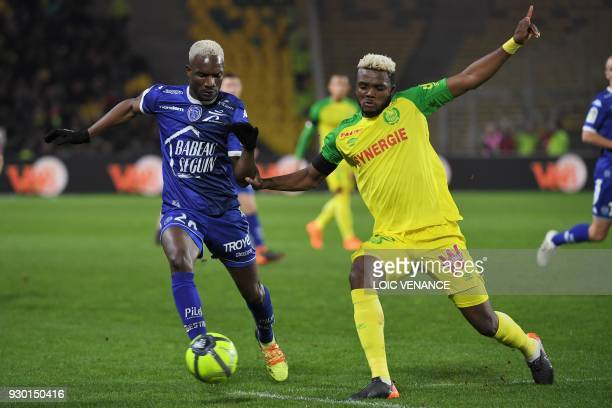 Troyes' Malian forward Adama Niane fights for the ball with Nantes' Nigerian defender Chidozie Awaziem during the French L1 football match between...