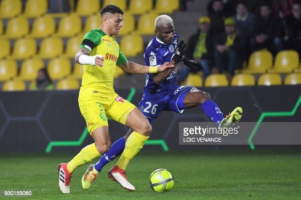 Troyes' Malian forward Adama Niane fights for the ball with Nantes' Brazilian defender Diego Carlos during the French L1 football match Nantes vs...