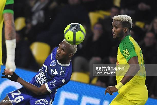 Troyes' Malian forward Adama Niane fights for the ball with Nantes' Nigerian defender Chidozie Awaziem during the French L1 football match Nantes vs...